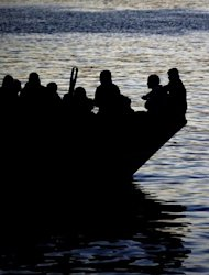 A boat carring Tunisian migrants enters the port of Lampedusa in 2011. Eritrean Abbes Settou, the sole survivor among some 50 migrants who died of hunger and thirst after their inflatable boat ruptured in the Mediterranean, said Wednesday he had survived &quot;by the grace of God.&quot;