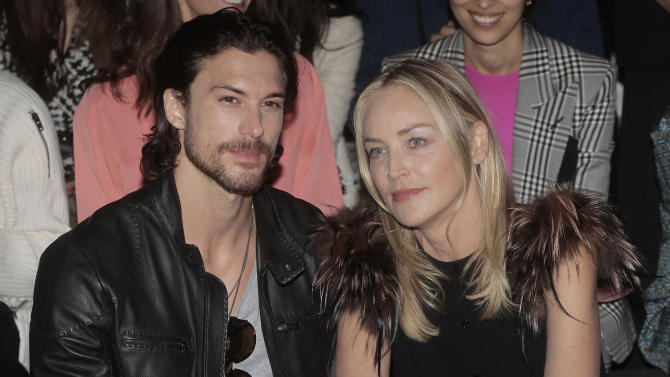 American actress Sharon Stone, right, poses with her boyfriend Martin Mica, of Argentina, prior to the start of the Fendi women's Spring-Summer 2013 fashion collection, during the fashion week in Milan, Italy, Saturday, Sept. 22, 2012. (AP Photo/Antonio Calanni)