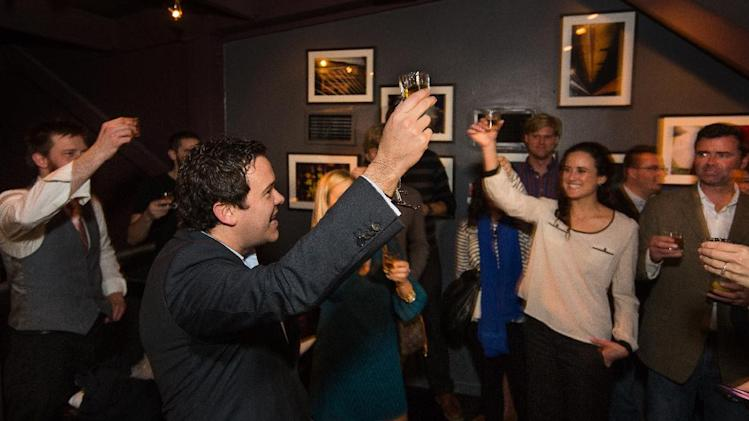 IMAGE DISTRIBUTED FOR CROWN ROYAL - Master of Whisky Gerry Graham leads a toast during the Charleston Crown Royal Maple Finished launch party at the Social Restaurant + Wine Bar on Wednesday, Jan. 30, 2013, in Charleston, S.C. (Mic Smith/AP Images for Crown Royal)