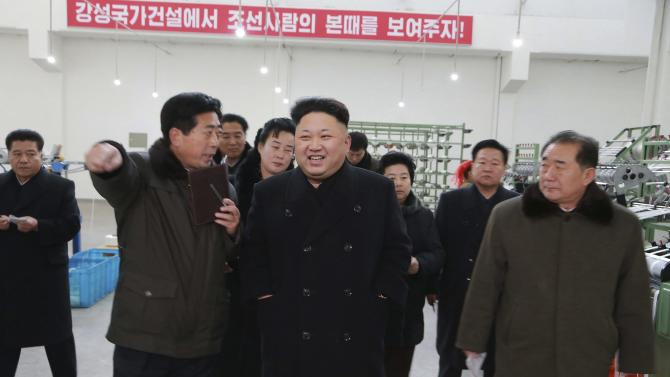 North Korean leader Kim gives field guidance at the Kim Jong Suk Pyongyang Textile Mill in this undated photo released by KCNA in Pyongyang
