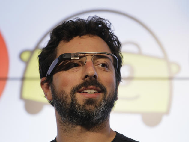 FILE - In this Tuesday, Sept. 25, 2012, file photo, Google co-founder Sergey Brin stands on stage during a bill signing by California Gov. Edmund G. Brown Jr., for driverless cars at Google headquarte