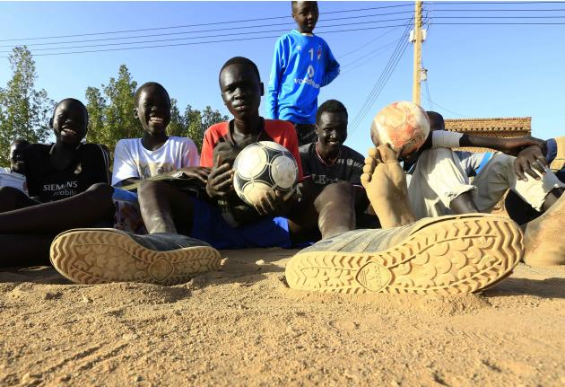 South Sudanese children living in the North rest after playing soccer in a IDPs camp at Hajj Yusuf in Khartoum