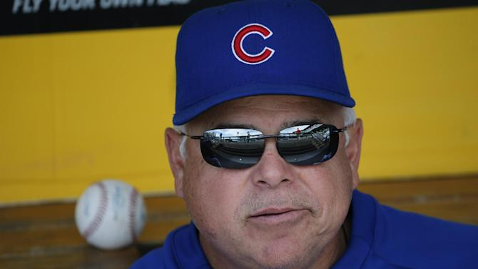 Chicago Cubs manager Rick Renteria sits in the dugout before a baseball game against the Pittsburgh Pirates in Pittsburgh Sunday, Sept. 14, 2014. (AP Photo/Gene J. Puskar)