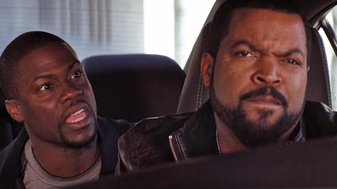 """This image released by Universal Pictures shows Ice Cube, right, and Kevin Hart in a scene from """"Ride Along."""" (AP Photo/Universal Pictures)"""