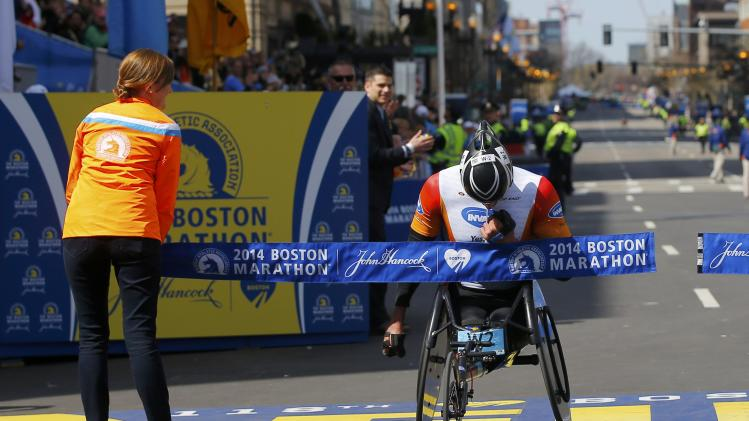 Ernst Van Dyk of South Africa wins the men's wheelchair division at the 118th running of the Boston Marathon in Boston