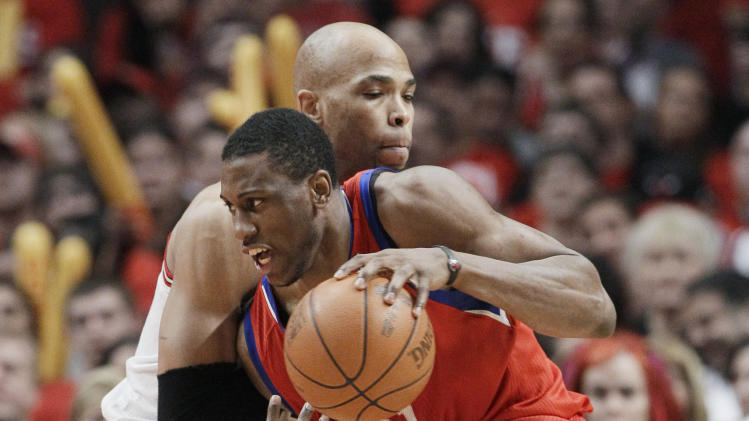 Philadelphia 76ers forward Thaddeus Young (21) drives to the basket against Chicago Bulls forward Taj Gibson during the third quarter of Game 2 in an NBA basketball first-round playoff series, in Chicago on Tuesday, May 1, 2012. (AP Photo/Nam Y. Huh)