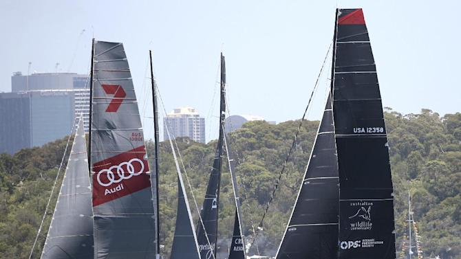 Comanche, right, and  Wild Oats XI, left, jostle for a start position before the start of the Sydney Hobart yacht race in Sydney, Australia, Friday, Dec. 26, 2014. (AP Photo/Rob Griffith)