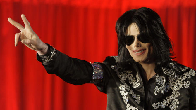 File - In this March 5, 2009 file photo, US singer Michael Jackson announces at a press conference that he is set to play ten live concerts at the London O2 Arena in July 2009. Jurors hearing a negligent hiring lawsuit in Los Angeles filed by Jackson's mother against AEG Live were shown emails on Wednesday May 29, 2013, that demonstrated the company's top executives expressed concerns about the singer's health in the days before his death. (AP Photo/Joel Ryan, File)