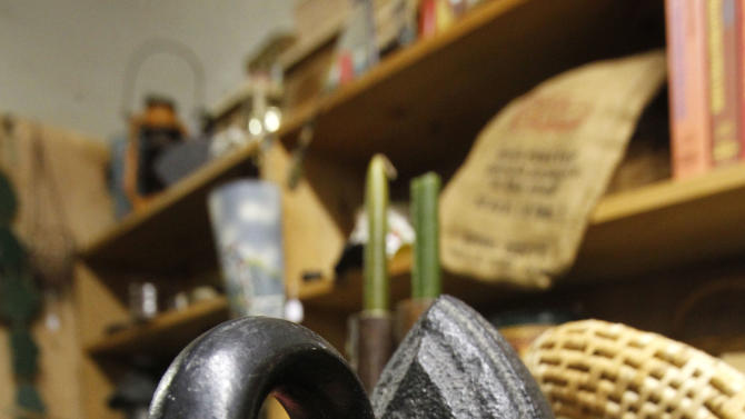 """An antique flat iron rests on display at a flea market, Thursday, Feb. 7, 2013 in Montpelier, Vt. When toymaker Hasbro axed the clothes iron token from its Monopoly game at the suggestion of online voters – replacing it with a cat – the company implied that the small household appliance was passe: something your grandmother once used to ease the wrinkles out of socks and handkerchiefs. Even with the rise of """"wrinkle-free,"""" the iron, it seems, is holding its own. While sales in the U.S. declined in volume 1 percent last year, they were up nearly 3 percent overall between 2007 and 2012, according to Euromonitor International. (AP Photo/Toby Talbot)"""