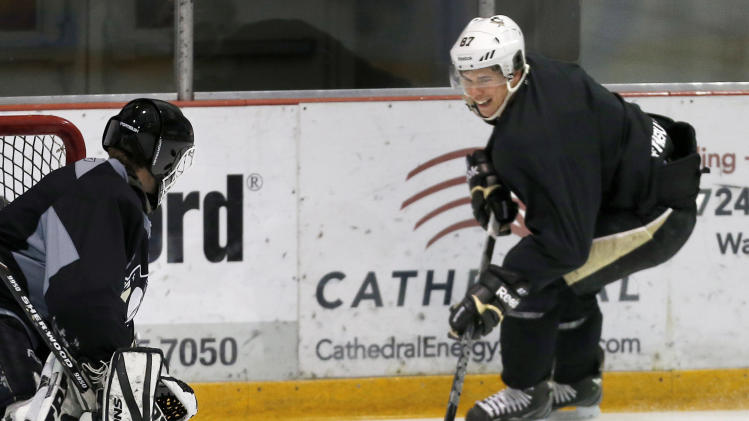 Pittsburgh Penguins' Sidney Crosby, right, skates in on a goalie during a hockey workout on Thursday, Jan. 3, 2013, at the IceoPlex in Canonsburg, Pa. Crosby knows the NHL season, if and when it starts, will be a sprint. That should favor teams like the Penguins, who endured little turnover in the long offseason. (AP Photo/Keith Srakocic)