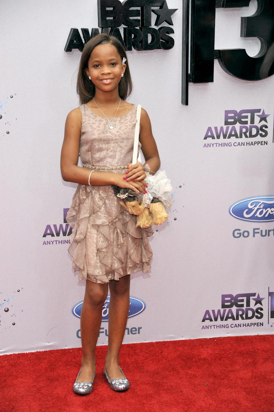 Quvenzhane Wallis arrives at the BET Awards at the Nokia Theatre on Sunday, June 30, 2013, in Los Angeles. (Photo by Chris Pizzello/Invision/AP)
