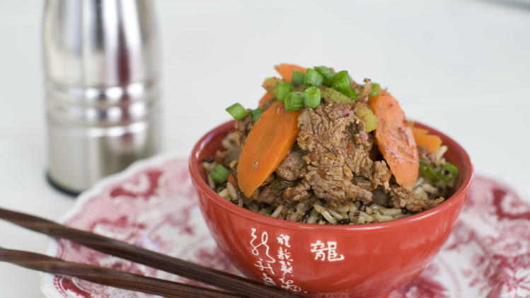 In this January 14, 2013 photo, a recipe for Sichuan beef is shown served in a bowl in Concord, N.H. (AP Photo/Matthew Mead)