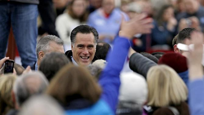 Republican presidential candidate, former Massachusetts Gov. Mitt Romney greets supporters at a campaign event at Portsmouth International Airport before departing for Iowa, Saturday, Nov. 3, 2012, in Newington, N.H. (AP Photo/David Goldman)