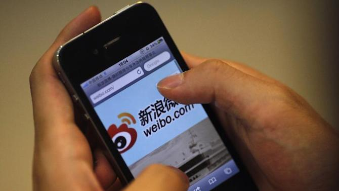 A man visits Sina's Weibo microblogging site in Shanghai