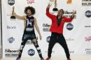 Redfoo and SkyBlu of LMFAO pose with their awards backstage during the Billboard Music Awards in Las Vegas