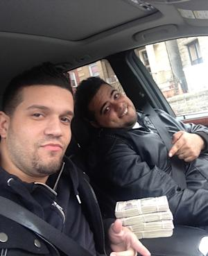 In this undated photo provided by the United States Attorney's Office for the Southern District of New York, Elvis Rafael Rodriguez, left, and Emir Yasser Yeje, pose with bundles of cash allegedly stolen using bogus magnetic swipe cards at cash machines throughout New York. Prosecutors in New York on Thursday, May 9, 2013 said that they are members of worldwide gang of criminals who stole $45 million in hours by hacking into a database of prepaid debit cards and draining cash machines around the globe. An indictment unsealed Thursday accused U.S. cell ringleader Alberto Yusi Lajud-Pena and seven other New York suspects of withdrawing $2.8 million in cash from hacked accounts in less than a day.  (AP Photos/U.S. Attorney's Office for the Southern District of New York)