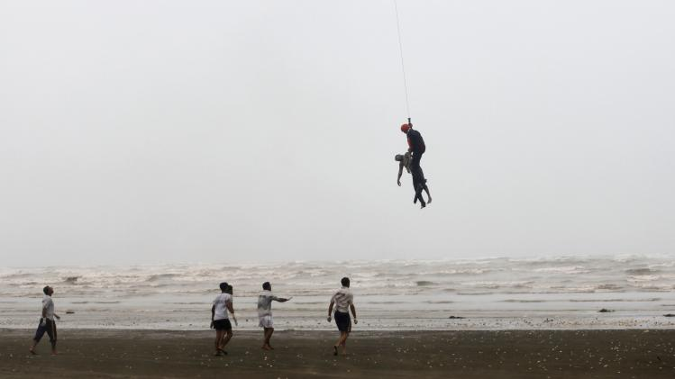 A Pakistan Navy diver holds the body of Sabir, who had drowned on Wednesday, at Karachi's Clifton beach