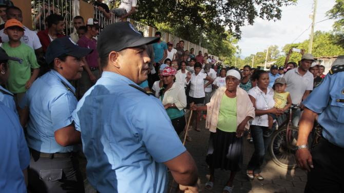 Residents are being blocked by police during a protest march against the construction of the Interoceanic Grand Canal in Rivas