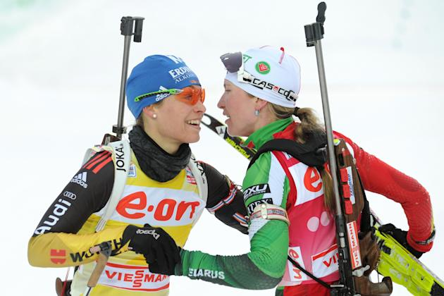 Belarus' Darya Domracheva (R) celebrates with Germany's Magdalena Neuner after winning the women's 12.5 km mass start event of the Biathlon Word Cup in the Siberian city of Khanty-Mansiysk, on March 1