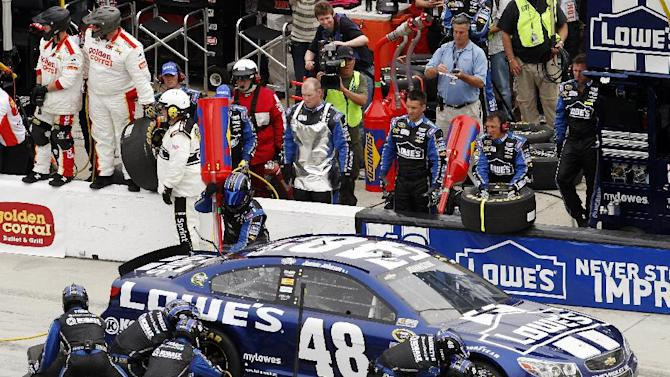 Jimmie Johnson pits for tires and fuel during the NASCAR Daytona 500 Sprint Cup Series auto race at Daytona International Speedway, Sunday, Feb. 24, 2013, in Daytona Beach, Fla. (AP Photo/David Graham)