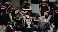 Pastor Maldonado of Venezuela and the Lotus team sits in his car surrounded by mechanics on February 28, 2014 during a four-day testing period at Bahrain's Sakhir circuit ahead of the Bahrain Formula One Grand Prix (AFP)
