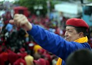 This photo, released by the Venezuelan presidency, shows president Hugo Chavez greeting supporters during a campaign rally for his re-election in Anzoategui, on July 12. Chavez said in a TV interview that Venezuela was not a threat to the United States, after Mitt Romney blasted President Barack Obama for downplaying the risk posed by the longtime US foe