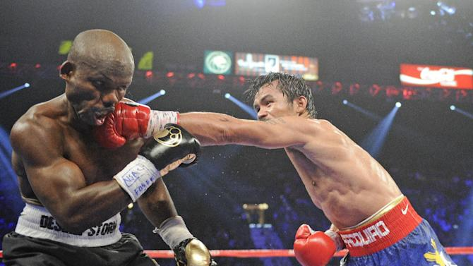 Manny Pacquiao, from the Philippines, right, lands a left to the head of Timothy Bradley, from Palm Springs, Calif., in their WBO world welterweight title fight Saturday, June 9, 2012, in Las Vegas. (AP Photo/Chris Carlson)