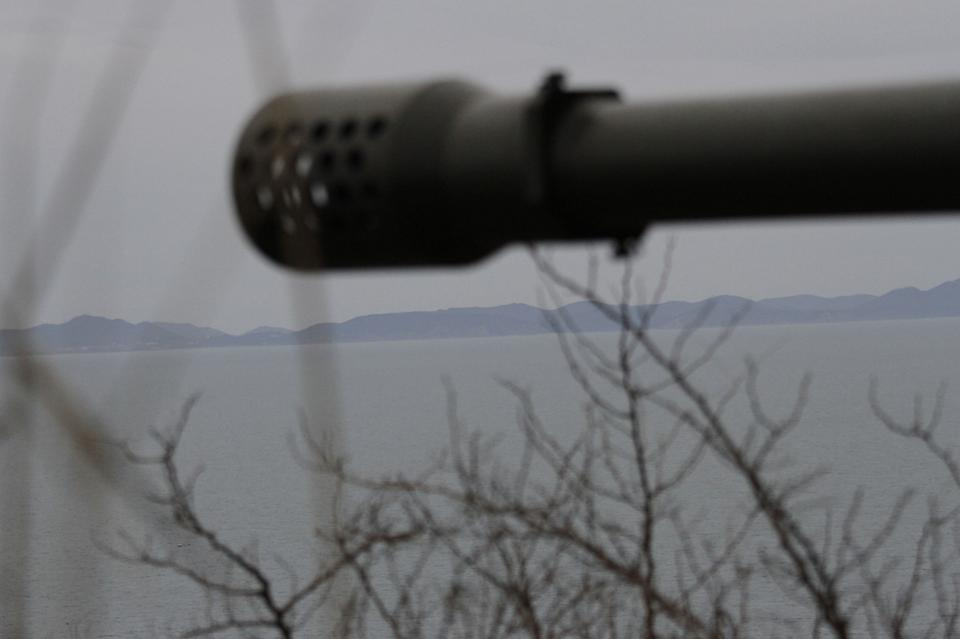 North Korean artillery is pointed from a military base on North Korea's southwest coast, opposite South Korea's Baengnyeong Island Monday March 5, 2012. (AP Photo/Kim Kwang Hyon)
