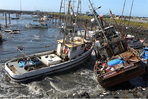FILE - In this March 11, 2011 file photo, boats collide with one another after a Tsunami surge of water swept through a boat basin in Crescent City, Calif. A new report released Wednesday, Sept. 4, 2013 found that a hypothetical mega-earthquake off the Alaska coast would swamp Los Angeles' port complex and cause widespread statewide economic loss. The scenario was released by the U.S. Geological Survey and others to help emergency planners prepare for a rare but possible event. (AP Photo/Bryant Anderson)