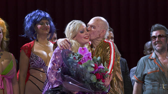 Anna Nicole played by actress Eva-Maria Westbroek receives a kiss from J. Howard Marshall II played by Alan Oke at the curtain call of Anna Nicole: An Opera in Two Acts Thursday, Feb. 17, 2011, at the Royal Opera House in London. (AP Photo/Joel Ryan)