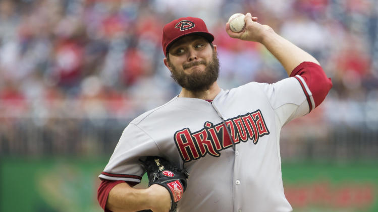 Arizona Diamondbacks starting pitcher Wade Miley deliver during the first inning of a baseball game against the Washington Nationals on Thursday, Aug. 21, 2014, in Washington. (AP Photo/Evan Vucci)