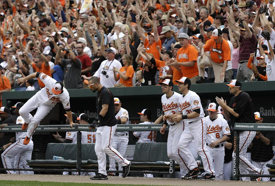 Members of the Baltimore Orioles walk onto the field after beating the Boston Red Sox 6-3 in a baseball game in Baltimore, Sunday, Sept. 30, 2012. (AP Photo/Patrick Semansky)