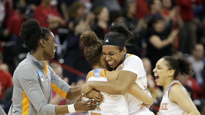 Tennessee players celebrate after winning a women's college basketball regional semifinal game against Gonzaga in the NCAA tournament, Saturday, March 28, 2015, in Spokane, Wash. Tennessee won 73-69 in overtime. (AP Photo/Young Kwak)