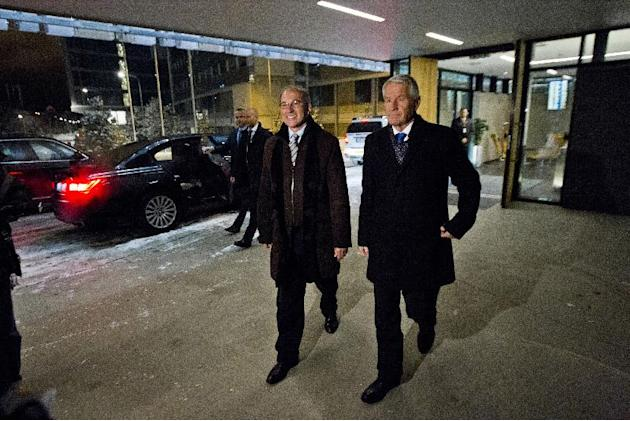 Organisation for the Prohibition of Chemical Weapons (OPCW) Director General Ahmet Uzumcu walks with Thorbjoern Jagland, chairman of the Norwegian Nobel Committee, as he arrives at Oslo airport