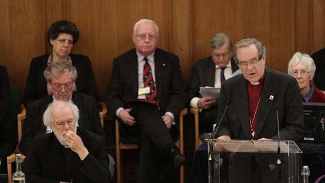 Dr Rowan Williams, left, the outgoing Archbishop of Canterbury listens to a speech by the Right Reverend Nigel McCulloch, Bishop of Manchester, during a meeting of the General Synod of the Church of England  in central London, Tuesday, Nov. 20, 2012,  - where a vote on whether to give final approval to legislation introducing the first women bishops will take place. The leader of the Church of England appealed for harmony among the faithful as it went into a vote Tuesday on whether to allow women to serve as bishops, a historic decision that comes after decades of debate. The push to muster a two-thirds majority among lay members of the General Synod is expected to be close, with many on both sides unsatisfied with a compromise proposal to accommodate individual parishes which spurn female bishops. (AP Photo/PA, Yui Mok)  UNITED KINGDOM OUT  NO SALES  NO ARCHIVE