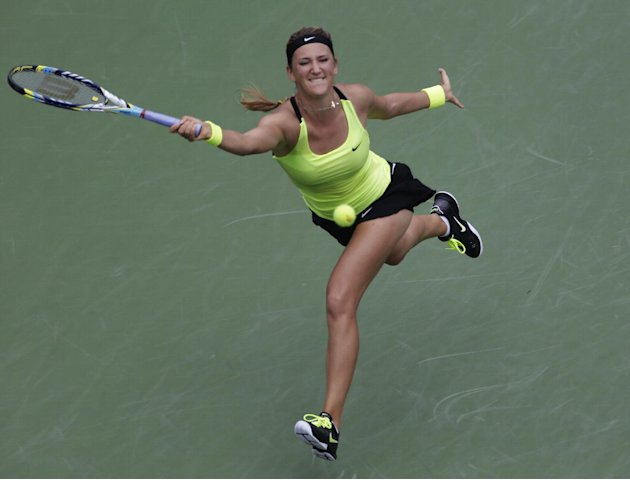 Victoria Azarenka, of Belarus, returns a shot to Samantha Stosur, of Australia, in the quarterfinals of the 2012 US Open tennis tournament, Tuesday, Sept. 4, 2012, in New York. (AP Photo/Kathy Willens