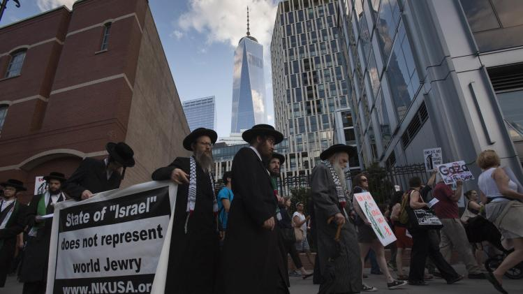 One World Trade Center is seen in the background during a protest march demanding an end to the recent Israeli-Palestinian violence through Lower Manhattan