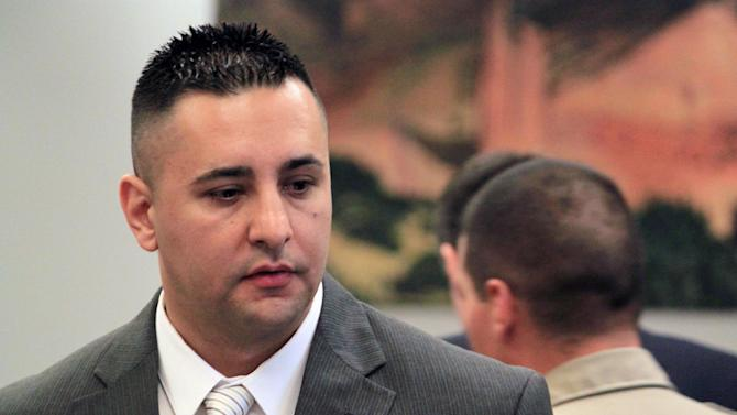 Former Albuquerque Police Officer Levi Chavez prepares to leave the courtroom following opening statements in his trial in Bernalillo, N.M., on Monday, June 10, 2013. Chavez is accused of killing his 26-year-old wife in the couple's home south of Albuquerque. His defense attorney disputes the allegations, saying the evidence points to suicide. (AP Photo/Susan Montoya Bryan)