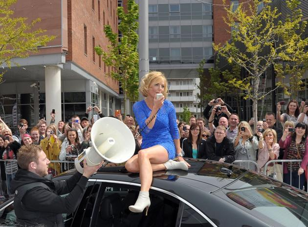 Celebrity photos: Geri Halliwell returned to The X Factor as a guest judge as the auditions kicked off this week. The star made a grand entrance, clambering out of her car and sitting on the roof, sho