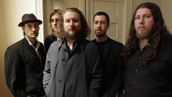In this Wednesday, April 13, 2011 photo, members of My Morning Jacket, from left, Bo Koster, Carl Broemel, Jim James, Tom Blankenship and Patrick Hallahan pose for a photograph in Louisville, Ky.  The band is scheduled to play at the 2012 Newport, R.I., Folk Festival. (AP Photo/Ed Reinke)