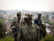 Colonel Sultani Makenga (C), head of the rebel M23 group, walks on a hill in Bunagana, a town near the Ugandan border. Rebel fighters in the Democratic Republic of Congo seized control Sunday of more towns in the country's east, but said they would cede most of their gains to UN peacekeepers and police