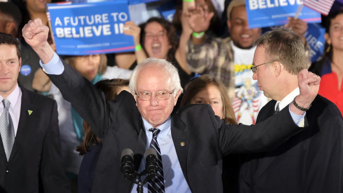 Democratic presidential candidate, Sen. Bernie Sanders, I-Vt., reacts to the cheering crowd at his primary night rally Tuesday, Feb. 9, 2016, in Manchester, N.H. (AP Photo/J. David Ake)