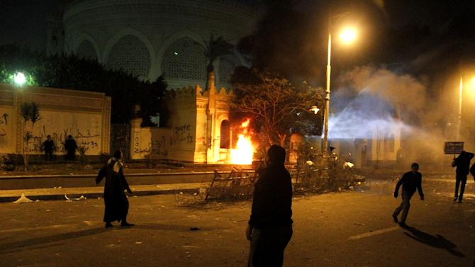 A bonfire burns as protesters clash with police outside Egypt's presidential palace in Cairo, Friday, Feb. 1, 2013. Thousands of protesters denouncing Egypt's Islamist president marched on his palace in Cairo on Friday, clashing with security forces firing tear gas and water cannons in the eighth day of the country's wave of political violence. (AP Photo/Mostafa El Shemy)
