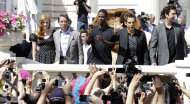 From left, actors Jessica Chastain, Martin Short, Chris Rock, Ben Stiller and David Schwimmer pose for fans during a photo call for Madagascar 3 during the 65th international film festival, in Cannes, southern France, Thursday, May 17, 2012. (AP Photo/Lionel Cironneau)