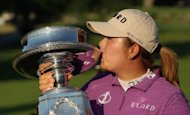 Feng Shanshan of China kisses the trophy on the 18th green after her two-stroke victory at the Wegmans LPGA Championship at Locust Hill Country Club in Pittsford, New York. Feng became the first Chinese golfer to win a major title by firing a bogey-free five-under par 67 on Sunday to capture the LPGA Championship by two strokes