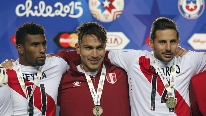Peru's Reyna, Guerrero and Pizarro pose with their medals after defeating Paraguay in their Copa America 2015 third-place soccer match at Estadio Municipal Alcaldesa Ester Roa Rebolledo in Concepcion