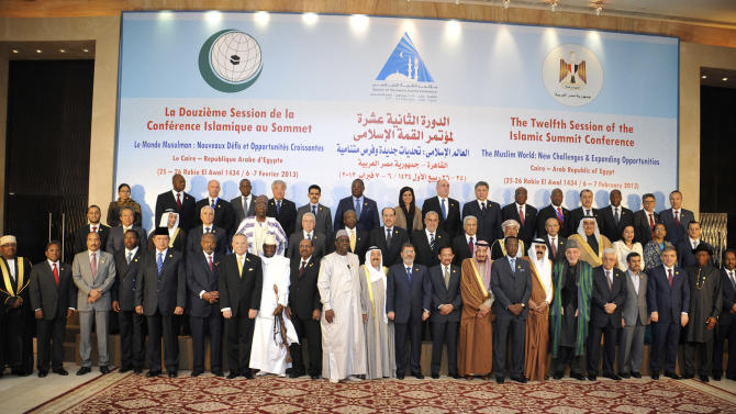 In this photo released by the Egyptian Presidency, leaders of nations taking part in the Organization of Islamic Cooperation's two-day summit, which brings together leaders from across the Muslim world, pose for a group photograph in Cairo, Egypt, Wednesday, Feb. 6, 2013. (AP Photo/Egyptian Presidency)
