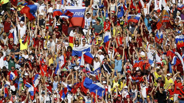 Russia fans cheer during the 2014 World Cup Group H soccer match between Belgium and Russia at the Maracana stadium