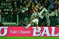 Juventus' midfielder Andrea Pirlo celebrates after scoring a goal during an Italian Serie A football match against Roma at the Juventus stadium in Turin