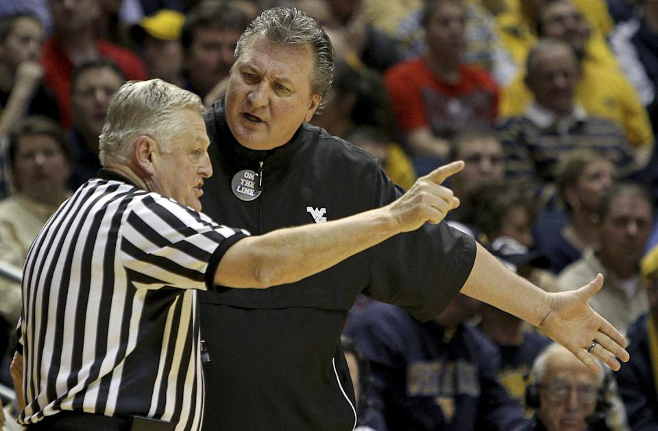 West Virginia coach Bob Huggins argues with referee Jim Burr in the second half of an NCAA college basketball game against Marquette in Morgantown, W.Va., on Friday, Feb. 24, 2012. Marquette won 61-60. (AP Photo/David Smith)